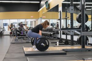 Lifting weights in the gym